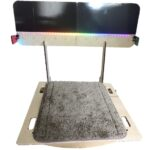 A photograph of the balance number line, consisting a wooden board and line mounted on stand. is large flat surface resting curved tracks such that it can be rocked left to right. runs from negative 5 positive 5, lit up with rainbow leds, has shiny black magentized surface.